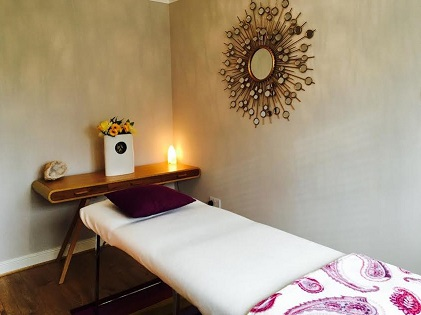 Holistic Therapy Hertfordshire - sunshine Holistics treatment room in Hertford with massage couch, sunshine mirror and soft lighting